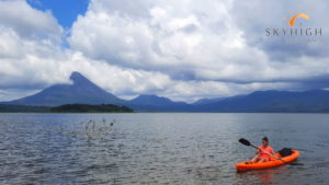 Kayak in front of the Arenal Volcano